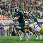 Couch: LJ Scott should worry Michigan State; Brian Lewerke should not