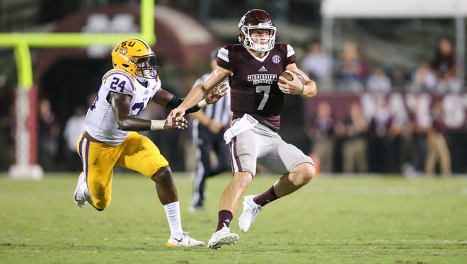 Mississippi State's Nick Fitzgerald (7) changes direction after a long run in the fourth quarter against LSU.