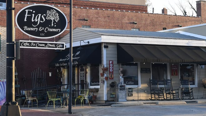 Business in downtown Anderson, including Figs Beanery & Creamery LLC on South Main Street.
