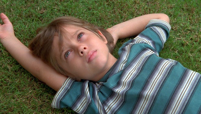 We watch Ellar Coltrane as Mason grow up in 'Boyhood,' which was filmed over a 12-year period.