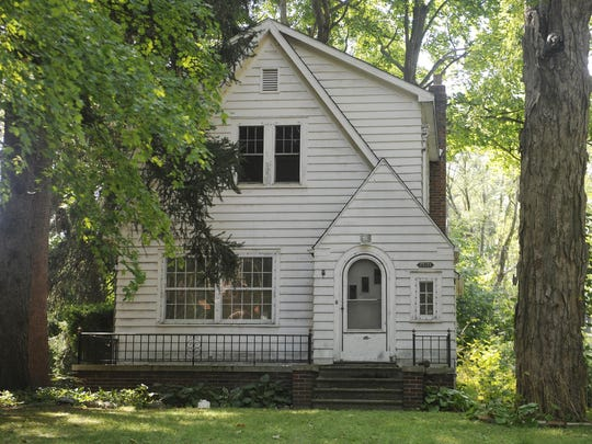 Neighbors fear the 95-year-old farmhouse on Puritan and Hazelton will be stripped and torched if it remains empty for long.