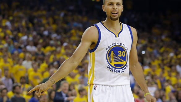 Golden State Warriors guard Stephen Curry (30) gestures during the first half of Game 7 of basketball's NBA Finals between the Warriors and the Cleveland Cavaliers in Oakland, Calif., Sunday, June 19, 2016. (AP Photo/Marcio Jose Sanchez) ORG XMIT: OAS132