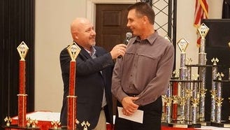 Scott Palmer, right, is introduced as the Late Model champion at Hagerstown Speedway's awards banquet recently.