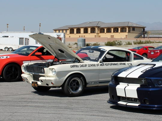 A 2012 Ford Mustang Boss 302, a 1965 Shelby GT350,