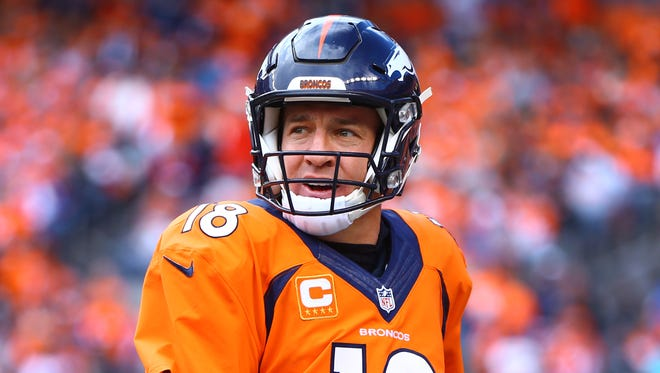 Denver Broncos quarterback Peyton Manning (18) against the New England Patriots in the AFC Championship football game at Sports Authority Field at Mile High.