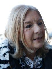 Arlene Schwartz of Suffern reacts to the federal arrest