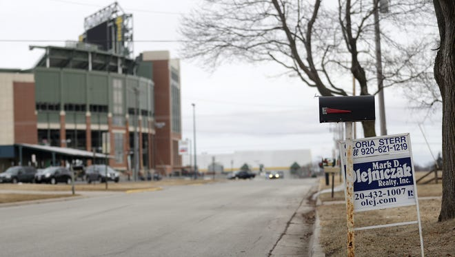 A for sale sign is posted in a front yard a block from Lambeau Field on Tuesday, March 20, 2018 in Ashwaubenon, Wis. Adam Wesley/USA TODAY NETWORK-Wisconsin