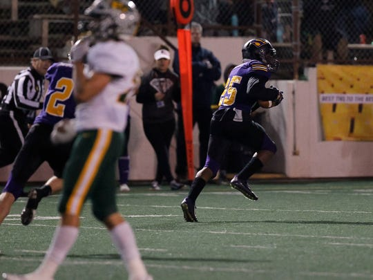 Salinas' Andre Calder returns an interception on a pass intended for Placer's Travis Warren (7) during an CIF Football Regionals: Division IV AA-North playoff game between the Salinas Cowboys and the Placer Hillmen of Auburn, CA at Salinas High School on Friday, December 8, 2017 in Salinas, Calif. Vernon McKnight/for The Californian