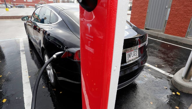 A Tesla is plugged in for the 30 minute charging cycle Saturday October 24, 2015 at Taylor Heights in Sheboygan.