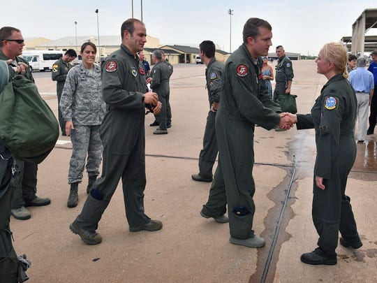 Fellow pilots, family and friends lined up to wish Col. Andrea Themely well after she completed her final flight as an Air Force Pilot Monday morning and was hosed down per tradition. Themely is retiring as the first female Commander of the 80th Flying Training Wing at Sheppard Air Force Base.
