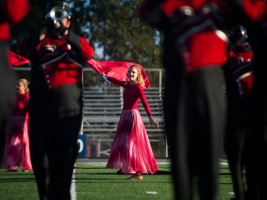 Central High School's marching band performs on the field during the Knox County Band Exhibition held at Farragut High School Thursday, Oct. 5, 2017.