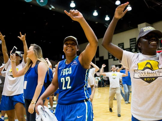 FGCU's China Dow, center, who was crowned ASUN tournament