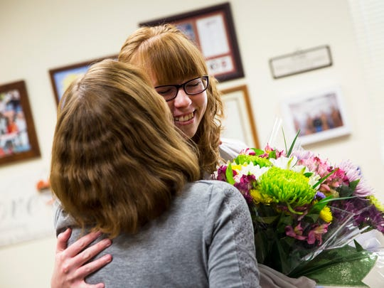 """Jessica Webb, 21, hugs her mom after receiving the adult volunteer of the year award at Big Cypress Elementary on Friday, April 7, 2017. The Outstanding School Volunteer Award is presented annually to a student, adult, and senior volunteer who has shown outstanding dedication and commitment to quality education in Florida. """"I like volunteering because it's very busy around here and it's nice to help take some of the load off of other people's shoulders,"""" says Webb."""