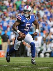 Bills quarterback Tyrod Taylor rolls out of the pocket.