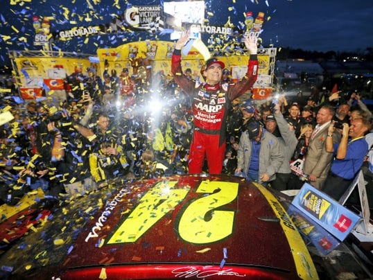 Jeff Gordon celebrates after winning the NASCAR Sprint Cup Series race at Martinsville Speedway in Martinsville, Va. on Sunday.