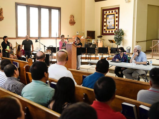 Congressman Tom Emmer, right, listened to testimony in Spanish through an interpreter during a public forum Sunday, Aug. 21, 2016, at the St. Joseph Church in Waite Park.