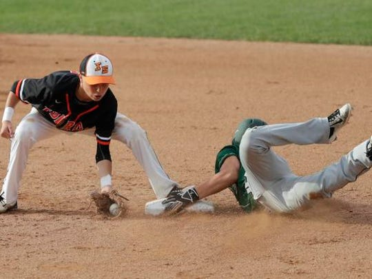 Iola-Scandinavia High School's Justin Sivertson, left, is late on the tag against Laconia High School's JakeBeattie during their WIAA Division 3 Spring Baseball Tournament semifinal game Wednesday, June 14, 2017, at Neuroscience Group Field at Fox Cities Stadium in Grand Chute, Wis. Dan Powers/USA TODAY NETWORK-Wisconsin