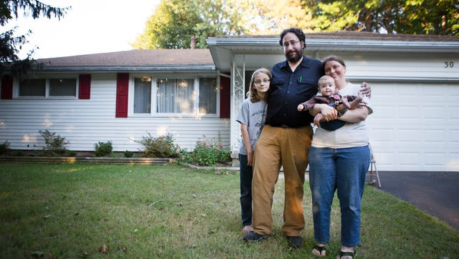 Ben and Wolf Kershner, with their children, Nathaniel, 10, and Amber, 6 months, took advantage of assistance for first-time homeowners to buy their house off Stone Road in Greece.