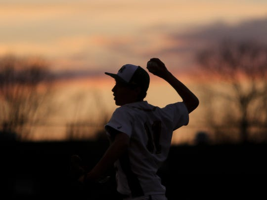 Northwest's Hunter Silverstrim pitches during their