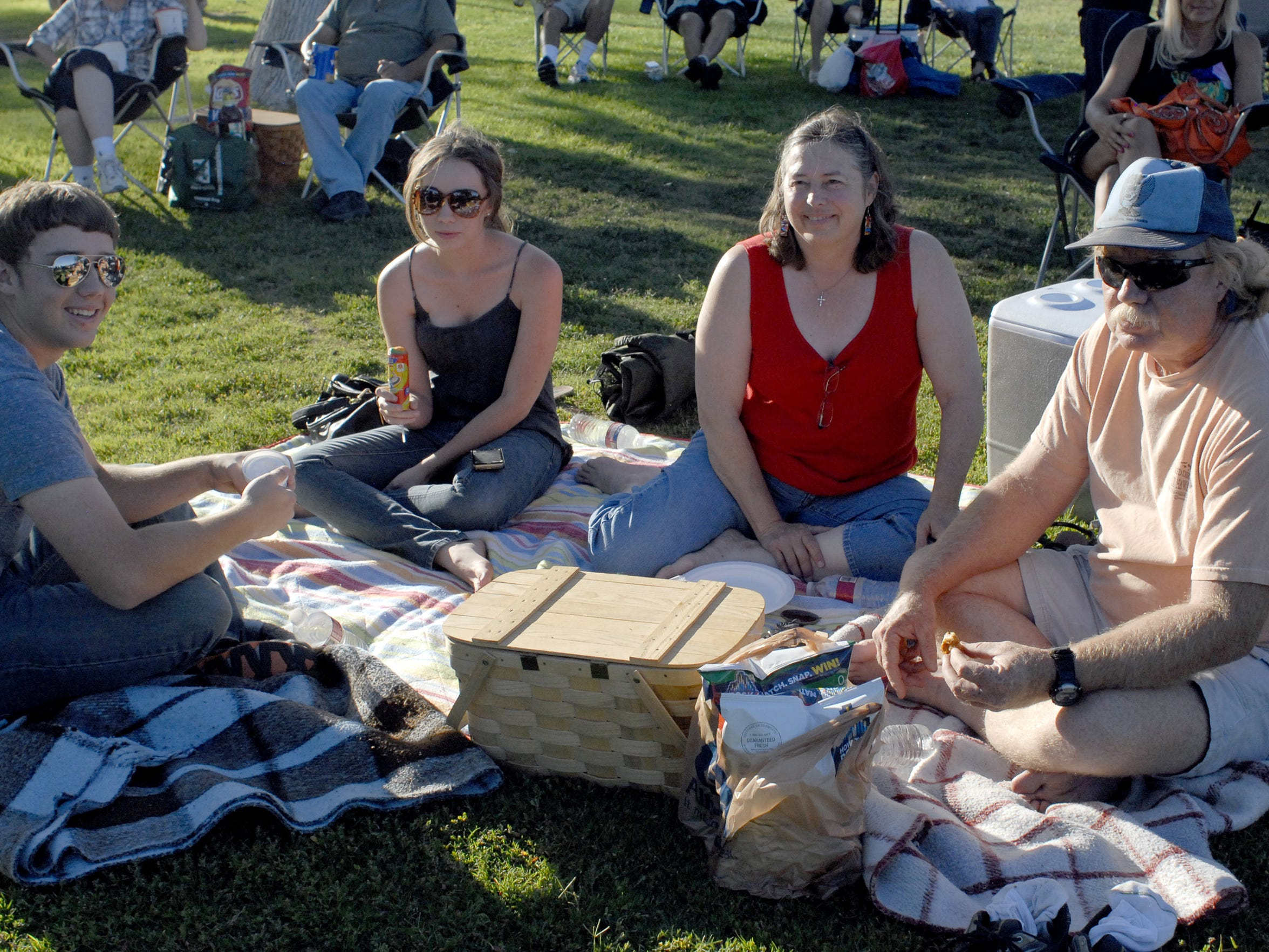 Matt, Kim, Ann and Pete Bellows prepare for a picnic and an evening concert at Apodaca Park, part of the the city's summer Music in the Park Series. This year, the series will be presented each Sunday throughout the summer starting at 7 p.m. at Young Park, 1905 E. Nevada Ave.