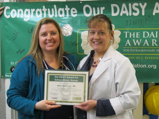 At left, Amy Hocevar — a registered nurse at the Aurora Sheboygan Memorial Medical Center — was recently honored with a DAISY Award, presented to nurses for outstanding care to patients. The DAISY Awards for Extraordinary Nurses is a national organization that recognizes nurses for their work. Award winners are nominated by nursing leadership at individual hospitals based on patient feedback.