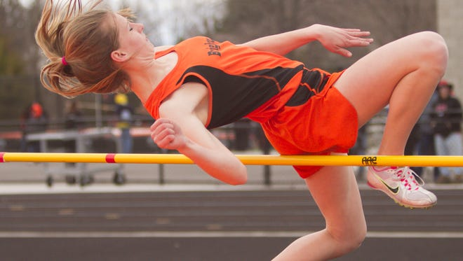 Brighton's Erin Dowd, shown competing in the high jump last year, won the 100 dash and both hurdles for the Bulldogs on Tuesday.