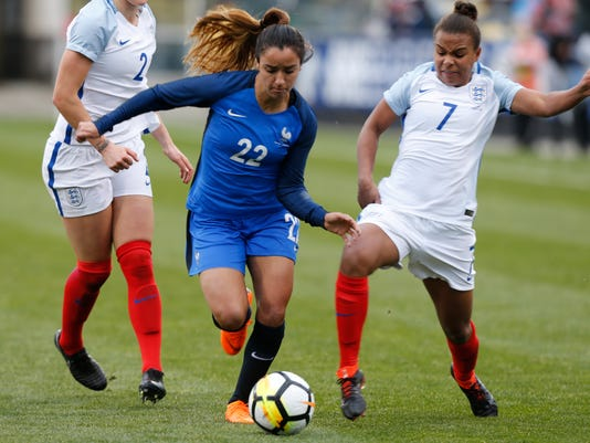 France's Sakina Karchaoui, left, and England's Nikita Parris fight for the ball during the first half of a SheBelieves Cup women's soccer match Thursday, March 1, 2018, in Columbus, Ohio. (AP Photo/Jay LaPrete)
