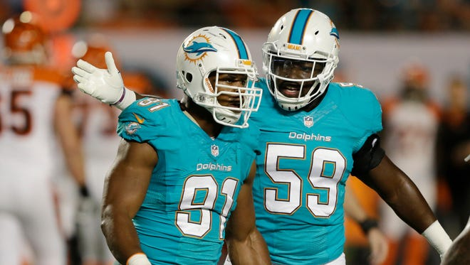 "Dolphins defensive end Cameron Wake, left, is part of the team's leadership council and met Wednesday to help ""push things in the right direction."""