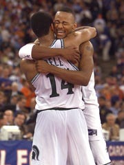 Morris Peterson and Charlie Bell hug after the Spartans' national championship victory over Florida in the NCAA Basketball Tournament.