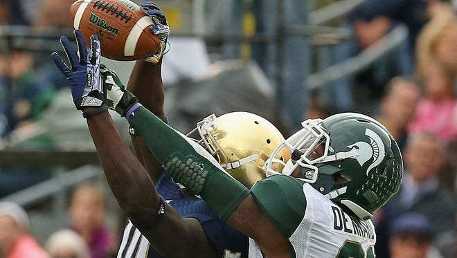 Darqueze Dennard, right, of the Michigan State Spartans breaks up a pass intended for DeVarius Daniels of Notre Dame on Sept. 21, 2013, in South Bend.