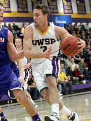 University of Wisconsin Stevens Point's Austin Ryf drives inside against Concordia University in the Quandt Fieldhouse in Stevens Point.