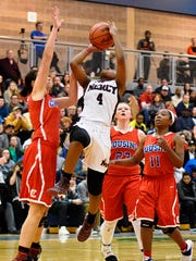 Mercy's Chloe Godbold (4) gets in the lane for a shot