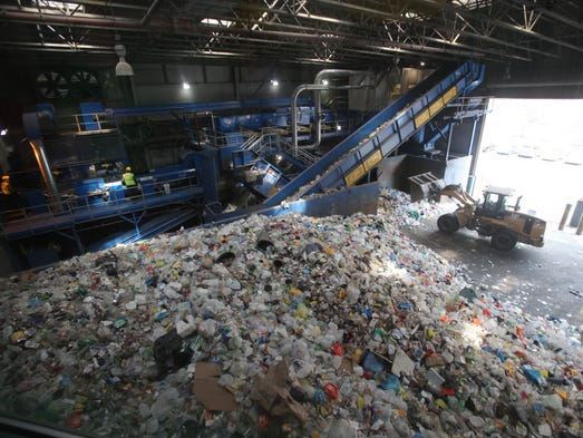 Large piles of plastic bottles, cartons, and cans wait to be sorted at Westchester's Material Recovery Facility in Yonkers April 11, 2014.