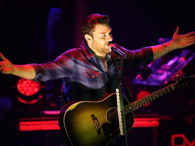 Country Music artist Chris Young acknowledges the crowd