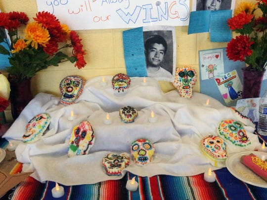 A memorial to student Diego Fernandez at Canutillo Middle School includes a Day of the Dead altar with figures, photos and flameless candles.