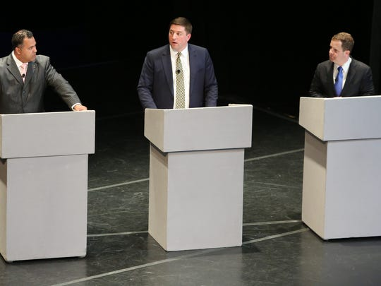 Three of four candidates for the Democratic nominee for Congress (from left) Mike Miller, Bryan Townsend and Sean Barney take part in a debate at the University of Delaware on April 12. The primary is in September.