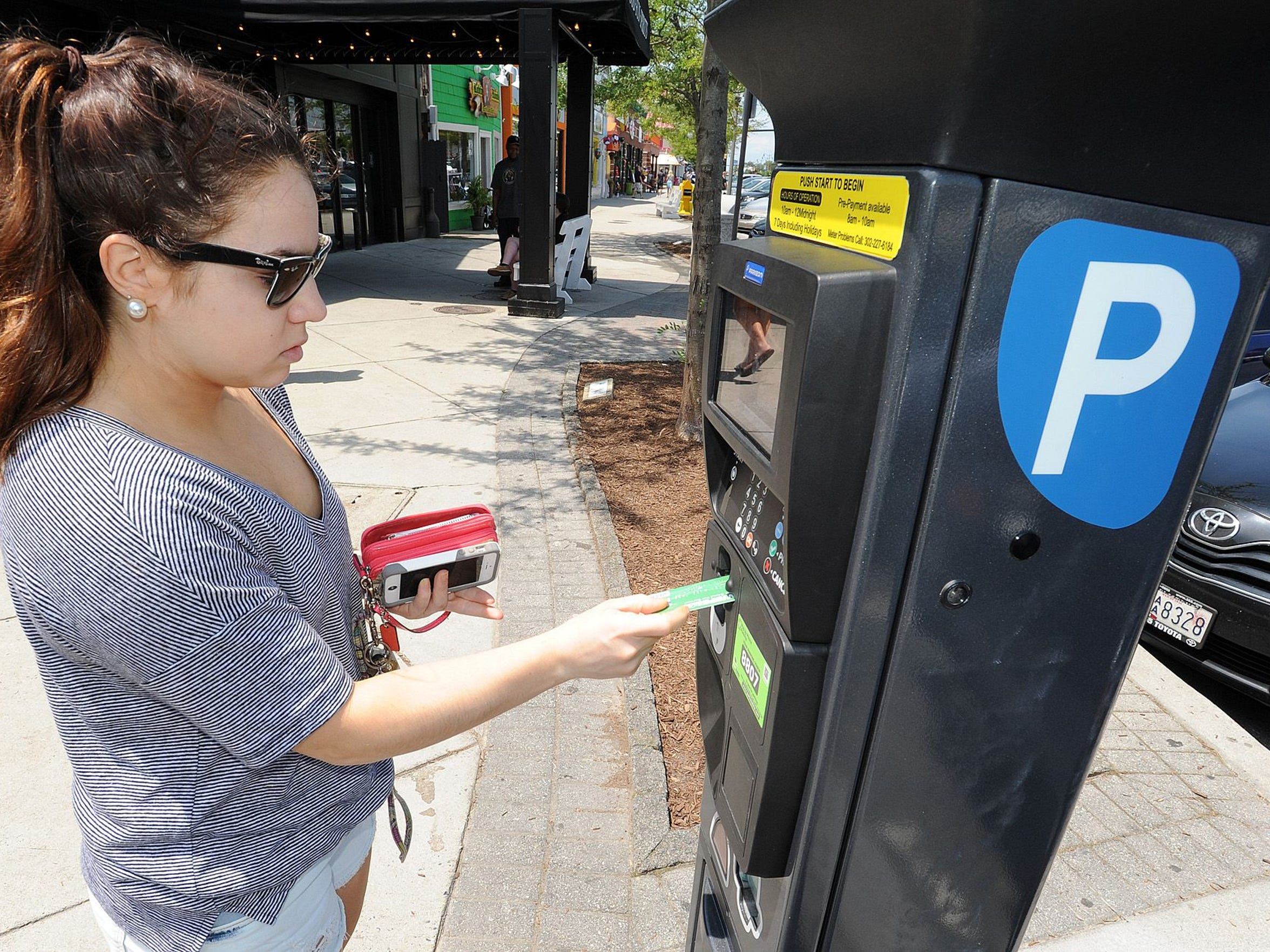 Olivia Marshall of Hockessin pays for parking with her credit card in Rehoboth.