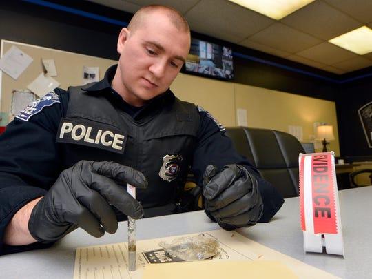 West York Borough Patrolman Sean Hightman tests a sample of marijuana headed for destruction, Monday, Jan. 16, 2017. The borough is considering a decriminalization ordinance.  John A. Pavoncello photo