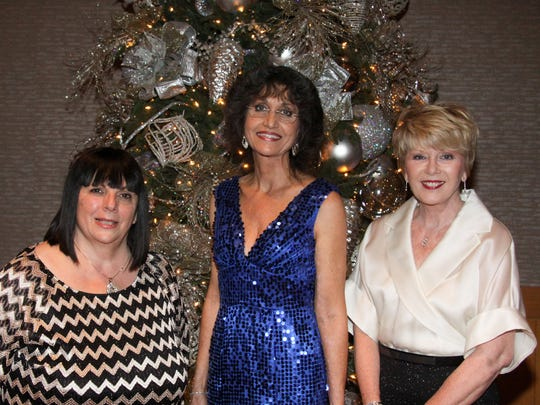 Gala co-chairs Kathleen von Dehn (left) and Margaret Cole (right) with Eisenhower Medical Center Auxiliary President Sandra Schulz (center).