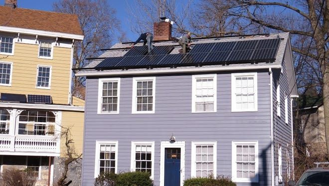 Solar panels being installed on the roof of a Broadway home in Hastings-on-Hudson.