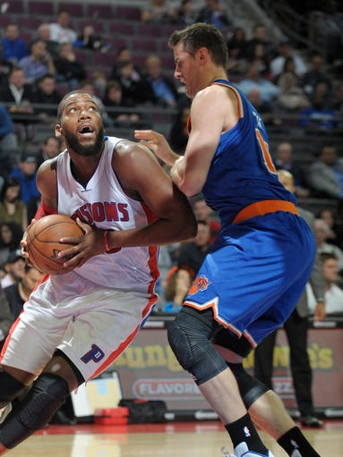 The Pistons' Greg Monroe drives around the Knicks'