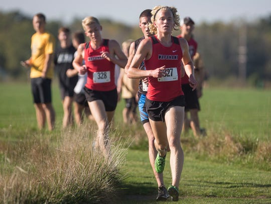 Wapahani's Alex Herbst runs with his brother closely