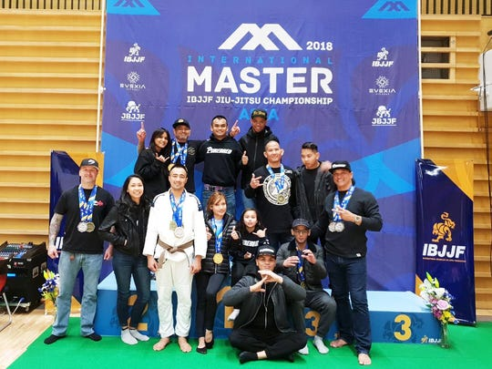 Purebred Jiu Jitsu Guam entered a masters team in a March 25 Tokyo Tournament: Pictured in front, from left, are:  Cort Jamison, Tasi Benavente, Richard Enriquez, Vanessa Bayudan, Kai Jamison, Lloyd Cubacub, RayPaul Jardon, Mark Smith Back row, from left, are:  Nina Acosta, Stephen Roberto, Oliver Cruz, David Harris, Robert Gutierrez and Seth Gutierrez