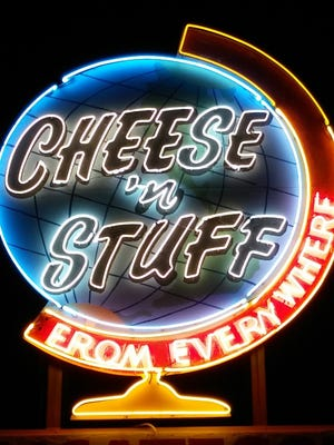 The Cheese 'n' Stuff Deli's rooftop sign is lighted for the first time in 20 years.