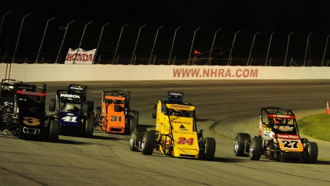 The Field Tracy Hines 24, leads the USAC Midget field out of turn four during the Night Before the 500, Saturday May 24, 2014 at Lucas Oil Raceway