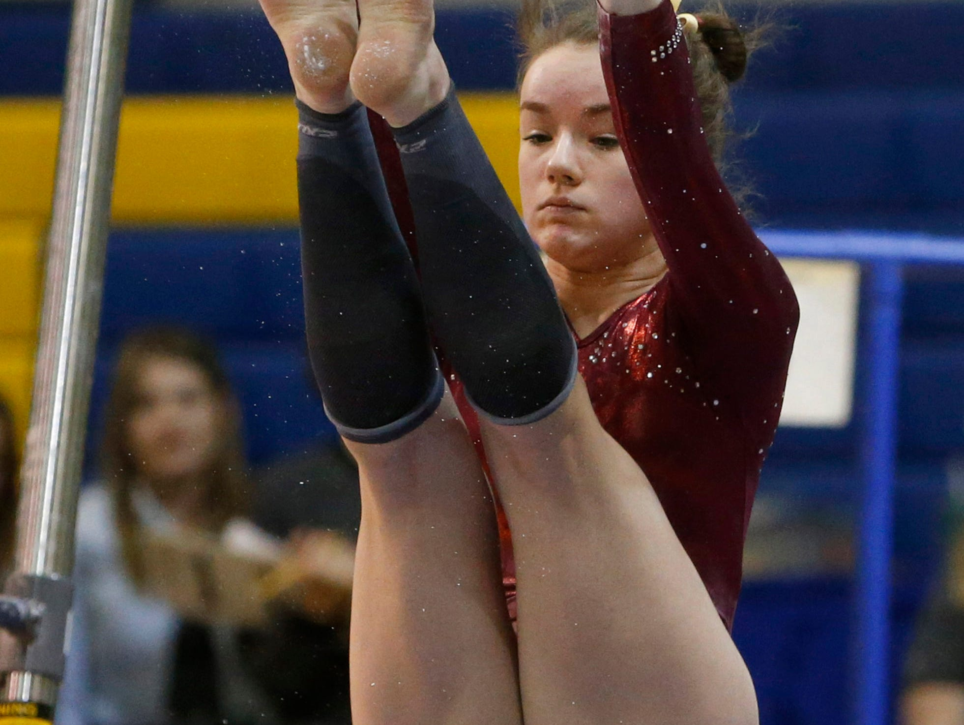 Sioux Falls Roosevelt's Jordyn Thoene competes on the bars during Saturday's individual competition at the Class AA State Gymnastics Meet at the Golden Eagles Arena.