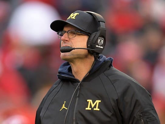 Michigan coach Jim Harbaugh watches action during the