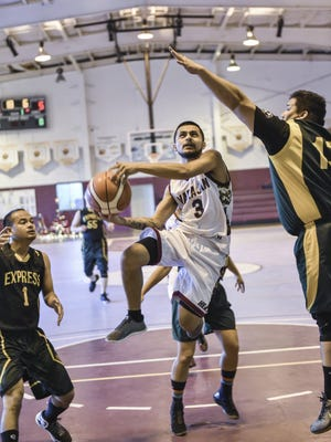 Bank of Guam played Inarajan in the Holiday Tip-off Tournament at the Tamuning Gym on Dec. 22.