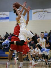 Kennan DeShambo of St. Mary Catholic puts up a shot against Brillion during a game earlier this season.