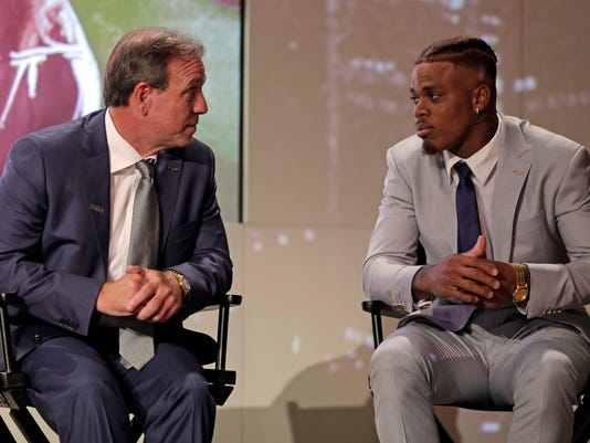 Florida State head coach Jimbo Fisher, left, talks with Deondre Francois, right, during the Atlantic Coast Conference NCAA college football media day in Charlotte, N.C., Thursday, July 13, 2017. (AP Photo/Chuck Burton)